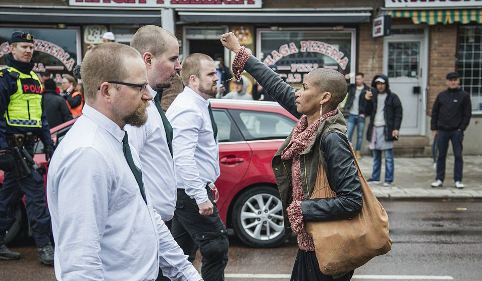 Tess Asplund, 42, stepped out in front of 300 Nazis marching through the city of Borlange, Sweden, and faced its leaders with her fist in the air